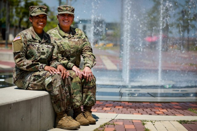 Maj. Eloisa Cox, brigade logistics officer, 3rd Armored Brigade Combat Team, 1st Armored Division shares a moment with her daughter, Spc. Ayana Anthony, a combat medic assigned to Charlie Company, 123rd Brigade Support Battalion, 3rd ABCT her while forward deployed to the Republic of Korea.