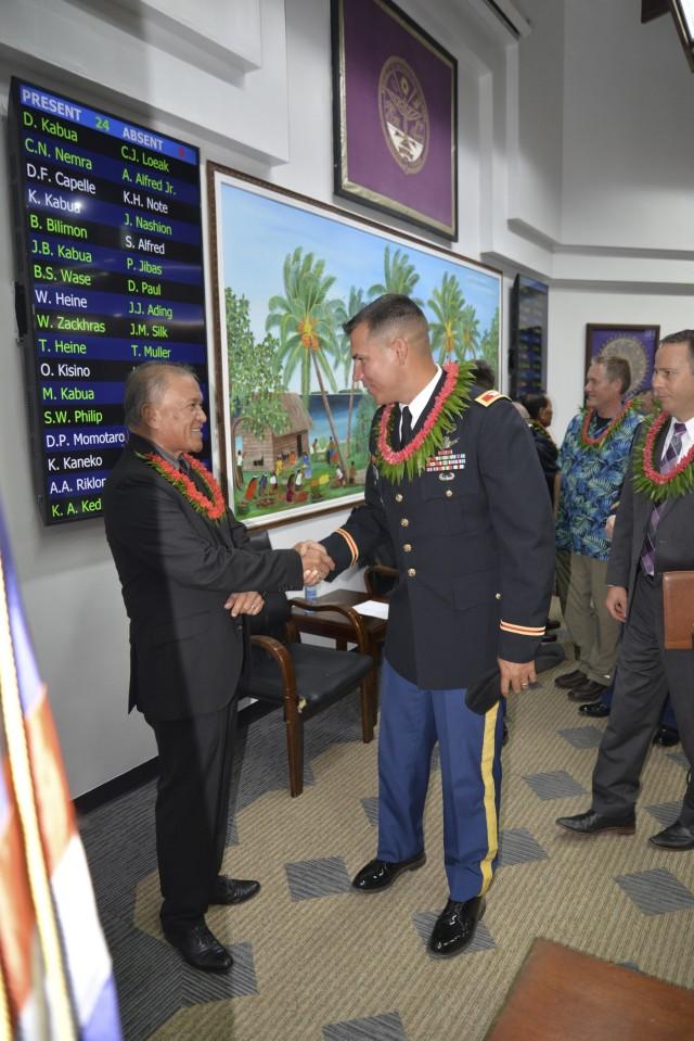 Republic of the Marshall Islands President David Kabua, left, greets U.S. Army Garrison-Kwajalein Atoll Commander Col. Thomas Pugsley at the Nitijela on Majuro Aug. 9, 2021.