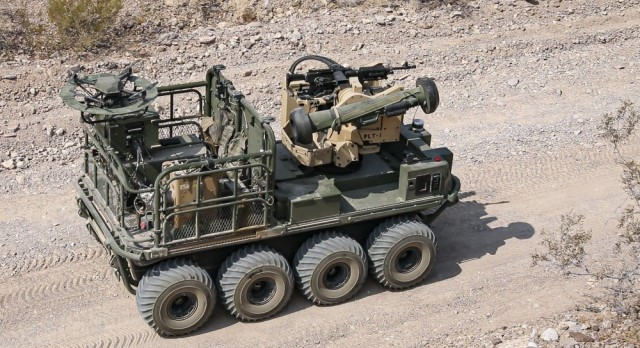 A U.S. Army autonomous weapons system, known as Origin, maneuvers through desert terrain as weapons testing commences during Project Convergence 20 at Yuma Proving Ground, Ariz., Aug. 25, 2020. During Project Convergence 21 in November, the Army will collaborate with five other military branches including the newly-formed Space Force.