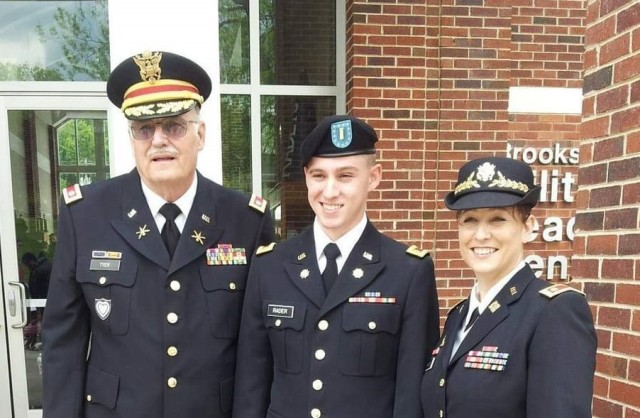 Lt. Col. (Retired) Gary Tyer, 2nd Lt. Greg Rader, and Lt. Col. Jennifer Rader, G3, 1st Theater Sustainment Command, celebrate Greg's graduation from training. Tyer is Lt. Col. Rader's father and grandfather to Greg.
