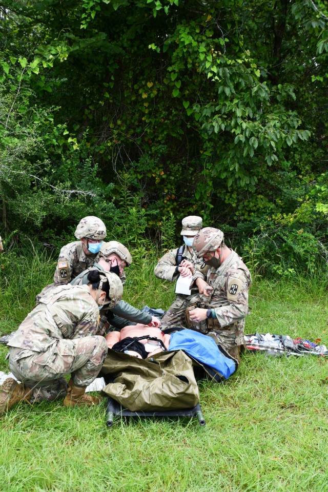 """Medics work on """"injured"""" Soldiers (manikins) during Delayed Evacuation Casualty Management course held on North Fort Aug. 6."""