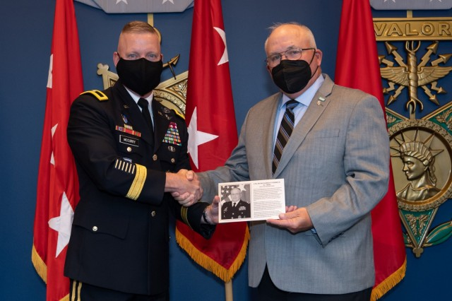 Retired Lt. Gen. Richard Formica, right, receives his honorary plaque from Brig. Gen. Michael McCurry, director of force development, G-8, after being inducted into the Force Management Hall of Fame at the Pentagon in Washington, D.C., Aug. 16, 2021.