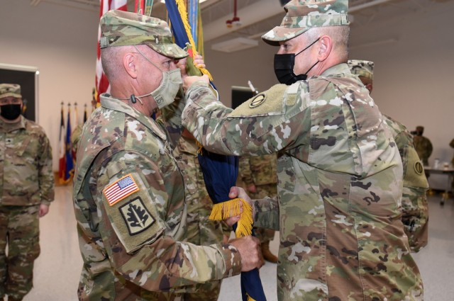 Incoming Command Sgt. Maj. Steven J. Slee, left, receives the colors from Brig. Gen. Ernest Litynski, Commanding General, 85th U.S. Army Reserve Support Command. Slee assumed command of the 85th USARSC, August 14, 2021.  (U.S. Army Reserve photo by SSG Erika F. Whitaker)