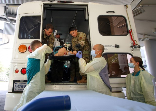 Cadet Lawrence Randall (left), a native of Wylie, Texas, and student at Stephen F. Austin State University at Nacogdoches, Texas, and Cadet Joelle Perry (far right), a Fairfax, Virginia native and student at James Madison University in Harrisonburg, Virginia, respond to a simulated casualty during a training exercise at the Intensive Care Unit at Landstuhl Regional Medical Center, Aug. 12.