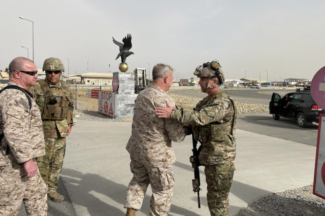U.S. Marine Corps Gen. Frank McKenzie, the commander of U.S. Central Command, meets with U.S. Navy Rear Adm. Peter Vasely, commander of U.S. Forces Afghanistan-Forward, at Hamid Karzai International Airport, Afghanistan on August 17, 2021. (U.S. Navy photo by Capt. William Urban)