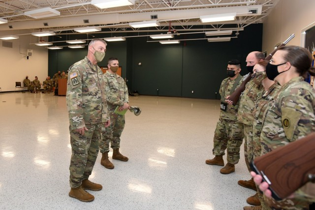 Command Sgt. Maj. Andrew J. Lombardo, left, Command Sergeant Major, U.S. Army Reserve, meets with Soldiers assigned to the 85th U.S. Army Reserve Support Command during a change of responsibility ceremony, August 14, 2021.  Command Sgt. Maj. Steven J. Slee assumed responsibility of the 85th USARSC from Command Sgt. Maj. Theodore H. Dewitt in Arlington Heights, Illinois.  (U.S. Army Reserve photo by SSG Erika F. Whitaker)