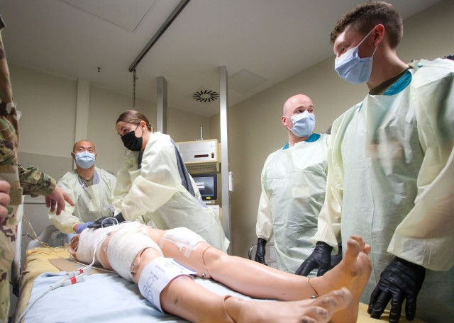 Cadet Teresa Novoa (second from left), a Stockton, California native and student at California State University, Fresno, performs CPR on a simulated casualty during a training exercise at the Intensive Care Unit at Landstuhl Regional Medical Center, Aug. 12.