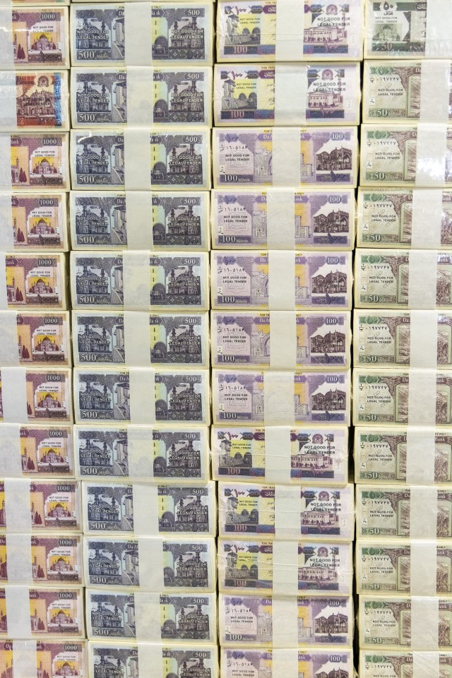 Exercise currency sits ready for use during Diamond Saber at Fort McCoy, Wisconsin, Aug. 14, 2021. Diamond Saber is a U.S. Army Reserve-led exercise that incorporates participation from all components and joint services, and it prepares finance and comptroller Soldiers on the warfighting functions of funding the force, payment support, disbursing operations, accounting, fiscal stewardship, auditability and data analytics. (U.S. Army photo by Mark R. W. Orders-Woempner)