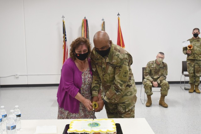 Command Sgt. Maj. Theodore H. Dewitt, outgoing command sergeant major for the 85th U.S. Army Reserve Support Command, along with his wife, Nancy, cut a ceremonial cake during his retirement ceremony, August 14, 2021. Dewitt retired from the U.S. Army after 36 years of service, culminating at the 85th USARSC.   (U.S. Army Reserve photo by SSG Erika F. Whitaker)