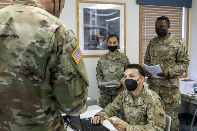 Spc. Domingo Perez-Lopez, 395th Financial Management Support Unit financial management specialist, receives simulated captured currency from 1st Lt. James Moore, 374th Financial Management Support Unit finance officer, during Diamond Saber at Fort McCoy, Wisconsin, Aug. 14, 2021. Diamond Saber is a U.S. Army Reserve-led exercise that incorporates participation from all components and joint services, and it prepares finance and comptroller Soldiers on the warfighting functions of funding the force, payment support, disbursing operations, accounting, fiscal stewardship, auditability and data analytics. (U.S. Army photo by Mark R. W. Orders-Woempner)