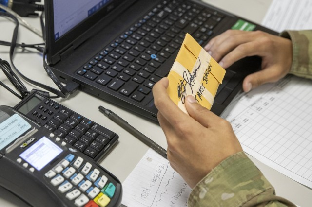 Spc. Domingo Perez-Lopez, 395th Financial Management Support Unit financial management specialist, logs in simulated captured currency using a financial management tactical platform, or FMTP, during Diamond Saber at Fort McCoy, Wisconsin, Aug. 14, 2021. Diamond Saber is a U.S. Army Reserve-led exercise that incorporates participation from all components and joint services, and it prepares finance and comptroller Soldiers on the warfighting functions of funding the force, payment support, disbursing operations, accounting, fiscal stewardship, auditability and data analytics. (U.S. Army photo by Mark R. W. Orders-Woempner)