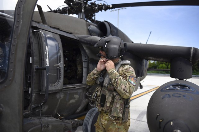 A U.S. Army Soldier with the 1st Battalion, 228th Aviation Regiment, Joint Task Force-Bravo, prepares to board a UH-60 Blackhawk helicopter at Grand Cayman, Cayman Islands, August 16. Helicopters with the 1-228 and personnel with JTF-Bravo deployed from Soto Cano Air Base, Honduras to support U.S. Southern Command operations to assist Haiti after a 7.2 earthquake devastated the country. JTF-Bravo will establish a forward operations center at Guantanamo Bay Naval Base and has deployed approximately 120 personnel to sustain relief efforts. (U.S. Air Force photo by Capt. Annabel Monroe)