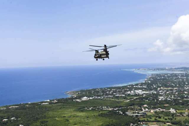 A U.S. Army CH-47 Chinook helicopter assigned to the 1st Battalion, 228th Aviation Regiment, Joint Task Force-Bravo flies off the coast Montego Bay, Jamaica, August 16. Two U.S. Army CH-47 Chinook and two UH-60 Black Hawk helicopters with the 1-228 deployed from Soto Cano Air Base, Honduras to support U.S. Southern Command operations to assist Haiti after a 7.2 earthquake devastated the country. (U.S. Air Force photo by Capt. Annabel Monroe)