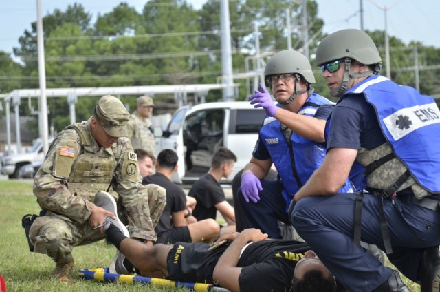 Fort Campbell Emergency Medical Services personnel evaluate a victim's condition Aug. 17 following an active shooter scenario at Building 6563, which was conducted as part of a full-scale exercise.