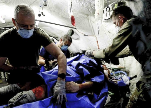 Landstuhl, Germany – Healthcare staff at Landstuhl Regional Medical Center treat a simulated trauma patient during a mass casualty exercise at LRMC, April 14. Landstuhl Regional Medical Center recently became the only medical facility outside the United States verified as a Level II Trauma Center by the American College of Surgeons. Previously verified as a Level III Trauma Center, LRMC's new designation reflects the medical center's commitment toward maintaining a robust trauma program in compliance with 286 criteria focused on immediate and comprehensive care following trauma incidents.
