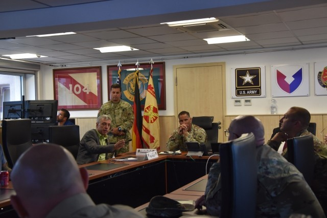 Col. Mario Washington, Wiesbaden Garrison commander, listens to input from Garrison directorate members during the Garrison tabletop exercise on a COVID outbreak at the Wiesbaden schools.