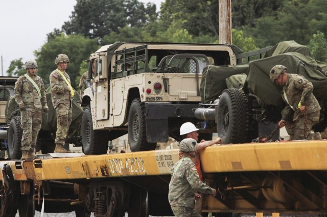 Soldiers and civilian employees team up to secure vehicles Aug. 16 at the Campbell Rail Operations Facility in support of 3rd Brigade Combat Team's upcoming Joint Readiness Training Exercise rotation at Fort Polk, La.