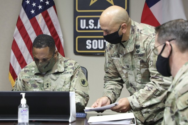 Maj. Gen. William L. Thigpen, left, U.S. Army South commanding general, signs agreed-to-actions during the 16th iteration of the U.S.-Chilean army-to-army staff talks with Col. Jeffrey T. Lopez, right, U.S. Army South Security Cooperation Directorate chief, Aug. 20, 2021, at the U.S. Army South headquarters. As the Army's Executive Agent, U.S. Army South conducts bilateral staff talks with partner nations in the U.S. Southern Command area of responsibility to strengthen the command's professional relationships and create training opportunities in the Western Hemisphere.