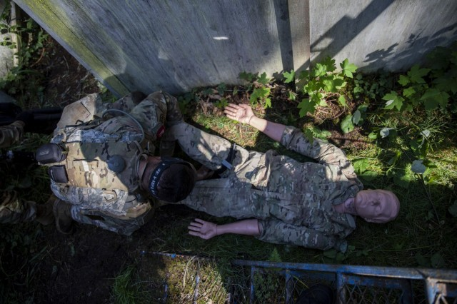 Spc. Jarrett Rodriguez from Desmond Doss Health Clinic participates in the mystery event where participants' objective was to clear multiple buildings then find, treat and extract a simulated casualty during the Regional Health Command-Pacific's Best Leader Competition Thursday, June 17th 2021 at Joint Base Lewis-McChord.   The Best Leader Competition promotes esprit de corps across the Army, while recognizing Soldiers who demonstrate the Army Values and embody the Warrior Ethos. The competition recognizes those Soldiers who possess superb military bearing and communication skills, in-depth knowledge of military subjects, and the ability to perform Soldier and warrior skills at levels above those of their peers. The winners of the competition will represent Regional Health Command-Pacific at the U.S. Army Medical Command Best Leader Competition, July 25-30, in Hawaii.