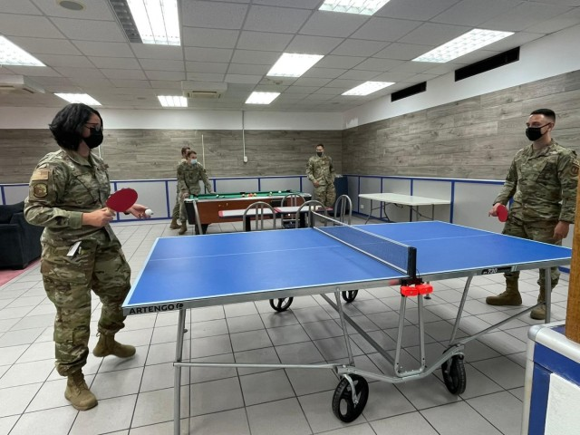 Camp Darby single service members craft their own recreation room