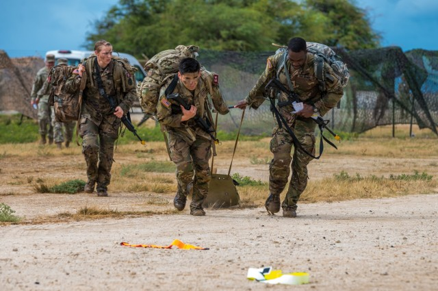 U.S. Army Staff Sgt. James Gabisum, and Sgt. Brenden Lopez, from Regional Health Command Europe, drag a skedco during the U.S. Army Medical Command (MEDCOM) 2021 Best Leader Competition, July 29, 2021, at Hickam Beach, Hawaii. The 2021 MEDCOM Best Leader Competition took place July 25-30, 2021, at Schofield Barracks, (Oahu), Hawaii. Sixteen Soldiers from the MEDCOM's four regions endured arduous combat focused events such as a taxing obstacle course; night land navigation through the jungles of Schofield Barracks; simulated combat medical care; and weapons fire under stress. Each of them with hopes of becoming the MEDCOM's Soldier or Non-Commissioned Officer (NCO) of the Year. The winners were announced at an award ceremony at Tripler Army Medical Center, in Honolulu on July 30. The winners will move forward to the Army's Best Warrior Competition in the fall to compete to be the Army's 2021 Soldier or NCO of the Year. For photos and video of the competition visit the event's page at: https://www.dvidshub.net/feature/ArmyMedicineBestLeaderCompetition and https://www.flickr.com/photos/armymedicine/. Also, follow us @ArmyMedicine, @CSMMEDCOM, and at www.facebook.com/OfficialArmyMedicine (U.S. Army photo by Cpl. Andrew Garcia)