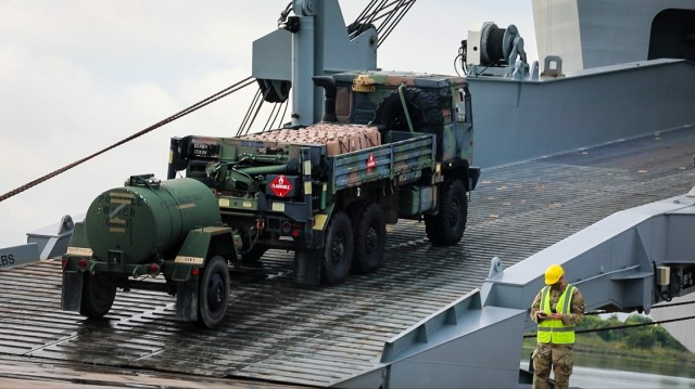 """3rd Brigade Combat Team """"Rakkasans,"""" 101st Airborne Division (Air Assault) conduct vessel loading operations aboard U.S. Naval Ship Gilliand, at Joint Base Charleston, S.C. The ship will be departing for Port Arthur, TX as 3rd Brigade executes their Sea Emergency Deployment Readiness Exercise.  (U.S. Army photos by Spc. Jacob Wachob, 40th Public Affairs Detachment)"""