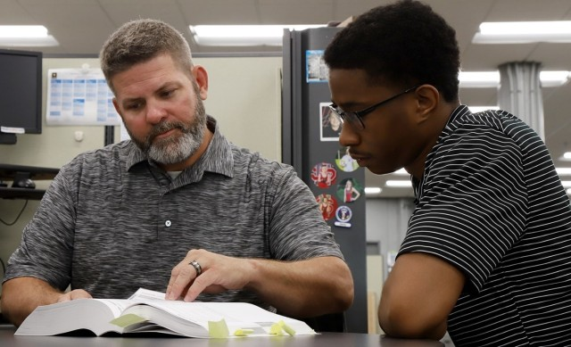 At left, mentor, Jerry Cuppy, Lead Ammunition Technical Specialist at JMC, shares his experience and knowledge with mentee, Charles Harris, a JMC intern.  The JMC's mentorship program is expected to serve as a way to transfer skills, knowledge and organizational culture from experienced to newer employees.