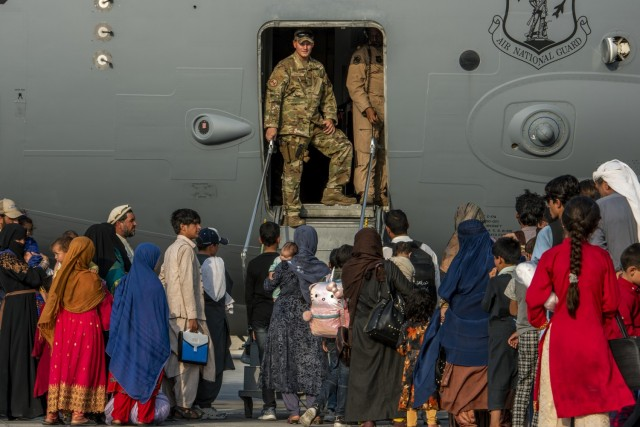Service members prepare to board evacuees onto a C-17 Globemaster lll Aug. 22, 2021, at Al Udeid Air Base, Qatar. The Department of Defense is committed to supporting the U.S. State Department in the departure of U.S. and allied civilian personnel from Afghanistan, and to evacuate Afghan allies to safety.
