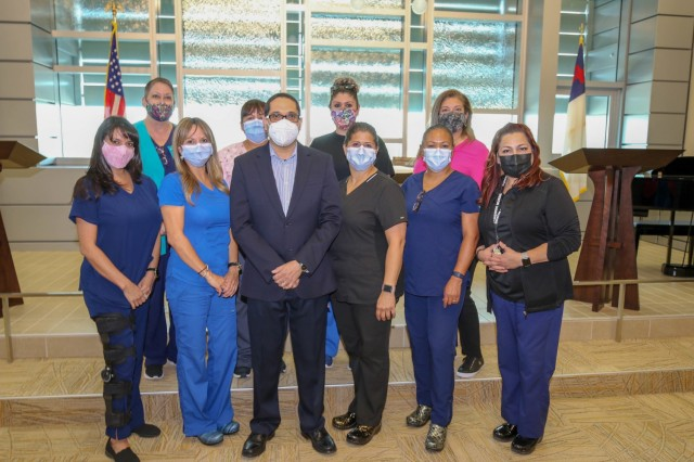 William Beaumont Army Medical Center Forensic Examiners gather for a photograph Aug.8 at the WBAMC Chapel. Forensic Examiners specializes in the care of survivors who have been victims of sexual assault and domestic abuse.( Photo by Vincent Byrd, WBAMC Public Affairs)