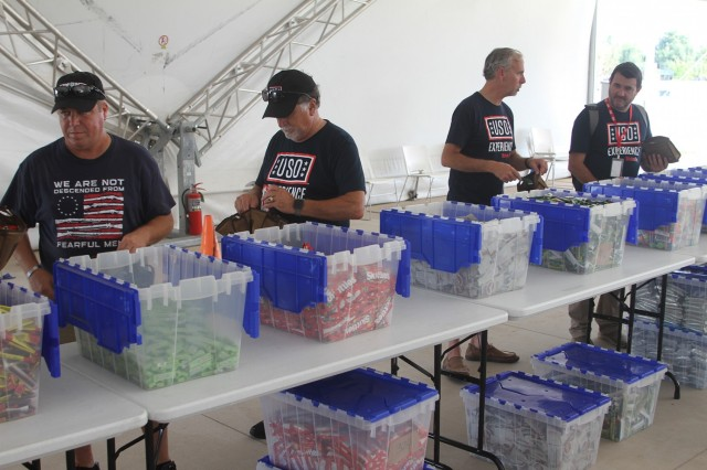 USO volunteers assemble a portion of 2,000 care packages during the USO Experience Aug. 22, in Oklahoma City. The care packages, requested online by service members, will be shipped to them overseas.