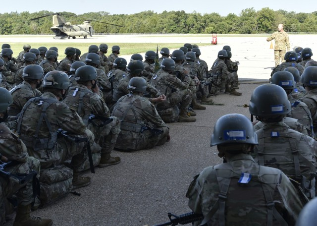 """More than 100 Military Police trainees from Company A, 701st Military Police Battalion, waited on the tarmac at Forney Airfield Monday morning to be airlifted by helicopter to begin what's called the """"Forge,"""" a 96-hour, cumulative field-training exercise that puts week-seven trainees in a patrol base as they encounter a multitude of combat and logistical scenarios. Not every trainee at Fort Leonard Wood gets a ride on an Army CH-47 Chinook helicopter, but when they can, drill sergeants here said they like to add that element to the training experience."""