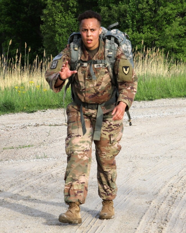Sgt. 1st Class Mikaela Clark, provost sergeant, U.S. Army Sustainment Command, reaches the half-way point of the 12-mile ruck march portion of ASC's Best Warrior Competition at Marseilles Training Center, Illinois, May 20.
