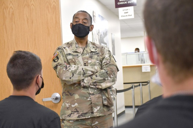 Maj. Gen. Jonathan Woodson, commanding general, Army Reserve Medical Command, speaks with cadets while touring the Soldier Readiness Processing site for the 2021 Cadet Summer Training on Monday, July 12. The SRP site is a part of the ARMEDCOM medical support offered annually to the Fort Knox, Ky. training exercise, and ensures cadets are medically safe to train in the exercise and ready for commissioning. The CST is the largest annual training exercise executed by the U.S. Army, graduating almost 10,000 Cadets from Advanced Camp or Basic Camp each summer. More than 250 ARMEDCOM Soldiers have provided support to the exercise, including medics, physicians, x-ray technicians, pharmacy technicians and lab technicians.