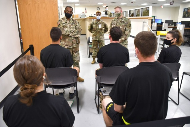 Maj. Gen. Jonathan Woodson, left, commanding general, Army Reserve Medical Command, talks to cadets while touring the Soldier Readiness Processing site for the 2021 Cadet Summer Training on Monday, July 12. Woodson was accompanied by CW5 John Horn jr., ARMEDCOM command chiref warrant officer, right. The SRP site is a part of the ARMEDCOM medical support offered annually to the Fort Knox, Ky. training exercise, and ensures cadets are medically safe to train in the exercise and ready for commissioning. CST is the largest annual training exercise executed by the U.S. Army, graduating almost 10,000 Cadets from Advanced Camp or Basic Camp each summer. More than 250 ARMEDCOM Soldiers have provided support to the exercise, including medics, physicians, x-ray technicians, pharmacy technicians and lab technicians.