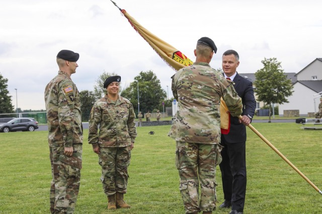 IMCOM-Europe Director Tommy Mize passes the colors to incoming Command Sgt. Maj. Christopher Truchon during the Change of Responsibility ceremony Aug. 27 at USAG Wiesbaden's Clay Kaserne.