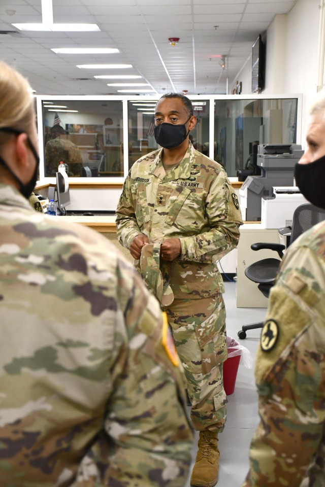 Maj. Gen. Jonathan Woodson, commanding general, Army Reserve Medical Command, speaks with ARMEDCOM Soldiers supporting the 2021 Cadet Summer Training while touring the Soldier Readiness Processing site on Monday, July 12. The SRP site is a part of the ARMEDCOM medical support offered annually to the Fort Knox, Ky. training exercise, and ensures cadets are medically safe to train in the exercise and ready for commissioning. The CST is the largest annual training exercise executed by the U.S. Army, graduating almost 10,000 Cadets from Advanced Camp or Basic Camp each summer. More than 250 ARMEDCOM Soldiers have provided support to the exercise, including medics, physicians, x-ray technicians, pharmacy technicians and lab technicians.