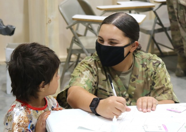 Guard Members assist U.S., Afghan civilians as part of Operation Allies Refuge