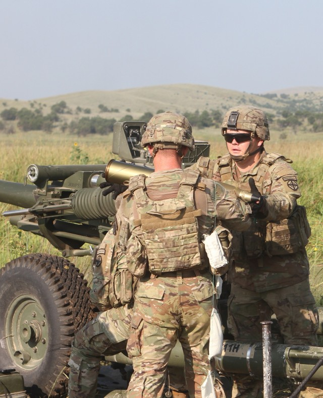 Spc. Dylan Horton, B Battery, 2nd Battalion, 2nd Field Artillery receives a 105mm shell during direct fire training Aug. 27, 2021, at Fort Sill, Oklahoma. Horton served as the assistant gunner for the field training.