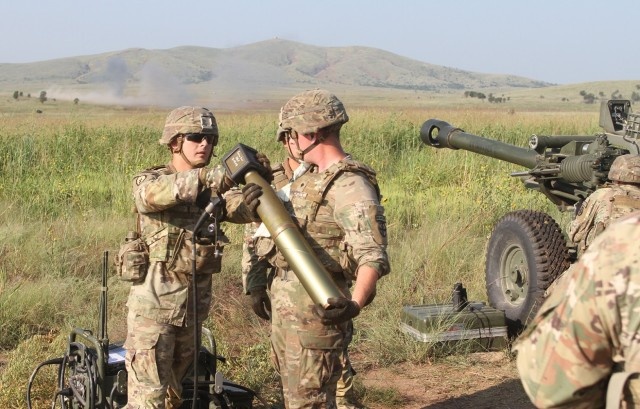 Sgt. Tyler Johnson uses a mission computer to set the fuze time on a 105mm artillery shell. 2nd Battalion, 2nd Field Artillery leaders held the artillery fire training Aug. 27, 2021, to help their Soldiers maintain readiness in their military occupational specialties.
