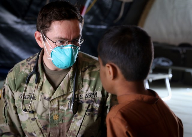 U.S. Army Maj. Philip Goering, a family medicine physician, U.S. Army Health Clinic Wiesbaden, Landstuhl Regional Medical Center, evaluates an Afghan evacuee seeking medical assistance as part of medical operations in support of Operation Allies Refuge at Ramstein Air Base, Germany, Aug. 26. The medical operations are part of U.S. Armed Forces medical efforts in response to the Afghanistan evacuations at Ramstein Air Base, which has transformed itself into the logistical hub for the evacuation of people from Afghanistan.