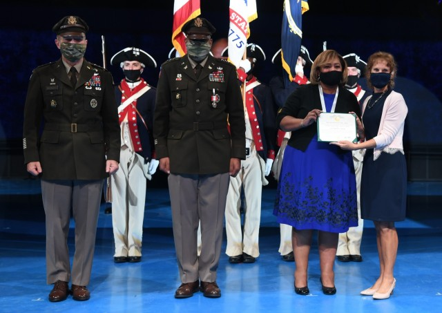 From left, U.S. Army Chief of Staff Gen. James McConville, left, Lt. Gen. Leslie C. Smith, the 66th Inspector General of the Army, Vanedra Smith, and Maria McConville stand after an awards presentation during Smith's retirement ceremony at Conmy Hall, Joint Base Myer-Henderson Hall, Virginia, Aug. 27, 2021. Lt. Gen. Smith was presented the Distinguished Service Medal, and Vanedra Smith received the Army Distinguished Public Service Medal (U.S. Army photo by Cpl. XaViera Masline)