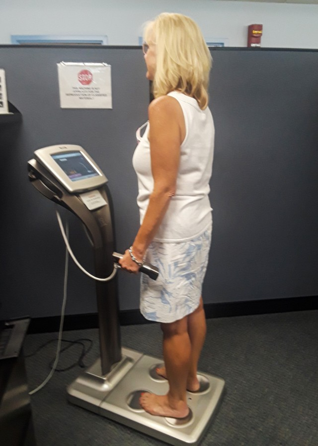Mary Ann Wicks, G1 (Human Resources), U.S. Army Sustainment Command, uses the Tanita body composition machine to provide a real-time snapshot of her physical health.  The body analysis information includes:  weight, body fat, body water, muscle mass, bone mass, basal metabolic rate, visceral fat, body mass index, and daily calorie intake.  (Photo courtesy of Linda Ottman, G1, ASC)