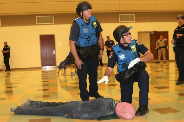 Left, Lt. Bryan Smart and Public Safety Officer Bradley Militano, both from the Sunnyvale Department of Public Safety (Fire) assess a simulated casualty as members of a Rescue Task Force during active-shooter response training, at the Sgt. James Witowski Armed Forces Reserve Center, in Mountain View, California, Aug. 26, 2021.