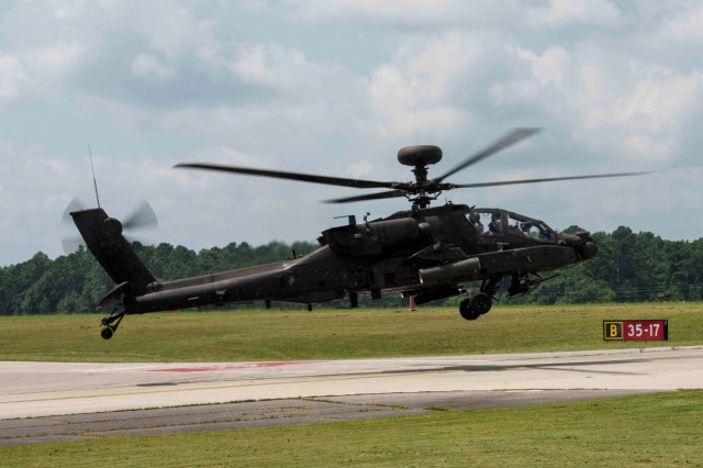 An AH-64E Returns from a demonstration flight during a capability demonstration July 13-4 Aug. at Redstone Army Airfield.  The event was hosted by The Apache Sensors Product Office in coordination with Redstone Test Center, the Future Vertical Lift- Cross Functional Team and a commercial vendor to showcase potential future cockpit technology.  (photo by Collin Magonigal)