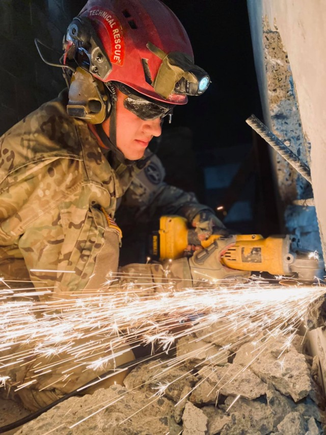A Soldier from the 911th Technical Rescue Engineer Company welds during a platoon validation exercise at the military operations in urban terrain facility on Marine Corps Base Quantico, Va., in April 2021.