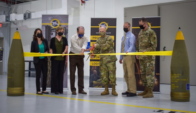 AMC and JMC commanders, Senator Mike Braun and Crane Army Ammunition Activity employees gather to cut the ribbon and ceremonially open Crane Army's newest facilities. From left: Lauren Shipman, CAAA civil engineer; Victoria McKibben, CAAA systems analyst; U.S. Senator Mike Braun; Gen. Ed Daly, commanding general of U.S. Army Materiel Command; Austin Harris, CAAA supervising manufacturing engineer; and Brig. Gen. Gavin Gardner, commanding general of Joint Munitions Command.   Photo by Lindsay Grant, Crane Army Ammunition Activity Public Affairs Office