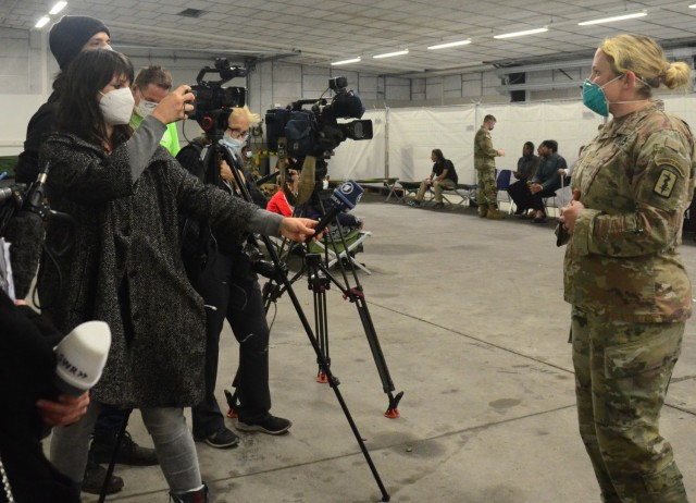 Maj. Karyn Kagel, an emergency medicine physician assistant with the 30th Medical Brigade, speaks to reporters on the health care being provided to evacuees at the Rhine Ordnance Barracks housing area.