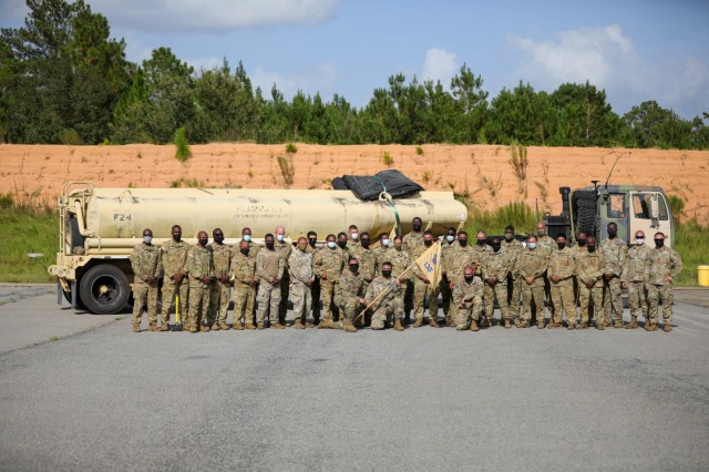 """Soldiers of the 135th Quartermaster Company, 87th Division Sustainment Support Battalion, 3rd Division Sustainment Brigade, 3rd Infantry Division, following the conclusion of a training event with 2nd Battalion, 3rd General Support Aviation Battalion """"Knighthawks,"""" 3rd Combat Aviation Brigade, on Fort Stewart, Georgia, August 26, 2021. This event was the capstone of a 10-week train up that focused on setting up and manning a forward arming and refueling point. (U.S. Army photo by Spc. Daniel Thompson/50th Public Affairs Detachment)"""