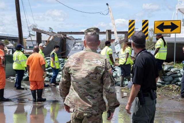 Col. James Slaven, assigned to the Louisiana National Guard, meets with St. Charles Parish emergency management officials in Hahnville, La., Aug. 30, 2021, during the recovery from Hurricane Ida.