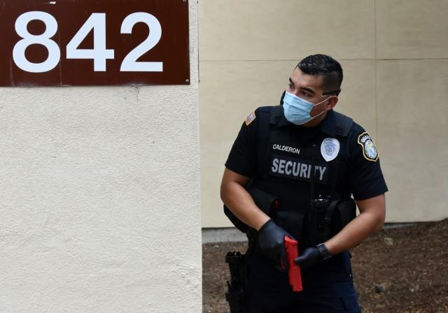 Officer Eli Calderon, a Presidio of Monterey security guard, participates in an active-shooter response drill at the Price Fitness Center, Presidio of Monterey, Calif., Aug. 5, 2021.